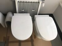 Back To Wall Toilets - 2 toilets with seats