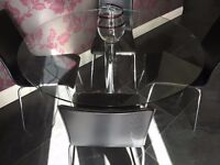 Marks and Spencer - Glass Top Table with Chrome base and 4 Black Leather Chairs