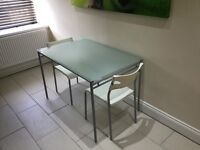 Ikea glass dining table + 2 chairs
