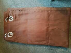 2 pairs of brown curtains