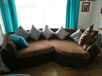 Large three piece suite with cuddle chairs and pouffee