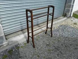 Dark wood towel rail