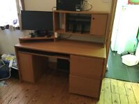 Computer desk with locked compartment and plug sockets