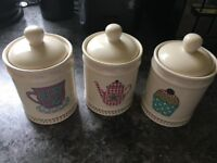 Tea, coffee and sugar canisters, plus utensils holder
