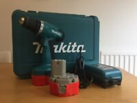 Makita drill with case and charger (14v) -- working, needs new battery