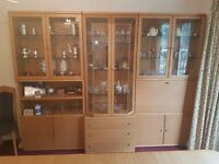 Hulsta light oak and glass storage units with drinks cabinet, cutlery drawers and integral lighting