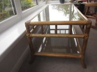Glass-topped cane conservatory table