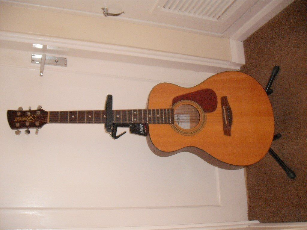Brunswick accoustic Guitar and stand.