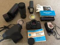 Excellent Praktica B200 SLR, plus Sigma 80-200mm lens, auto winder, Sunpak flash, light meter etc