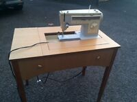 Singer sewing machine 413 with table selling for £100 on eBay!