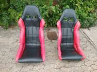 Sparco bucket seats and harnesses