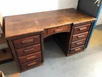 Quality pedestal office desk in dark oak.