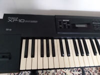 Vintage Roland XP10 Synthesizer with stand.