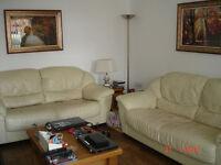 2 Two Seater Cream Leather Sofas