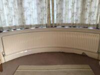 Large Curved bay window radiators