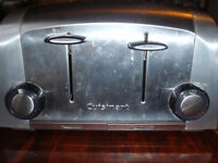Cuisinart 4 slice Toaster is in good condition and works well.