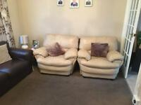 Brown leather two seat and two cream leather chairs