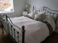 Silver kingsize bed