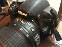 Nikon D3100 , nikkor 18-55 lens , charger and 2 batteries ,