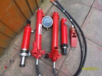 2 hydraulic pumps 2 rams oil filled gauges and an hydraulic jaw