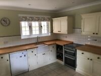 Solid pine man made units with butcher block worktops and butler sink