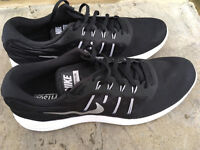 Almost new black Nike Trainers, size 10 uk