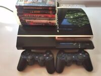 PS3 with 2 controllers, 6 games and cables