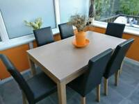 Large Dining Table and Six Brown Leather Chairs