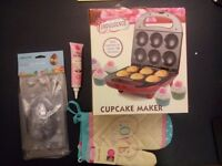 Brand new baking equipment - cupcake oven, gloves and icing tools