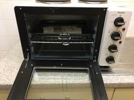 Mini cooker and microwave.