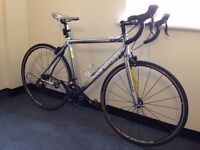 boardman comp entry level road bike racer carbon forks puncher proof tyres lightweight bike