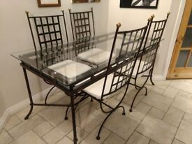 Glass Topped Metal Dining Room Table and Chairs