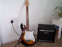 Peavey Raptor Special Guitar with strap and Peavey Rage 15w Amplifier and Tuner