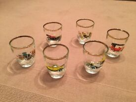 Small gold ringed glasses engraved with vintage cars