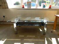 Glass coffee table for sale due to new arrival.