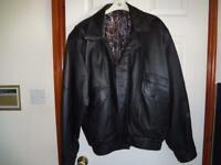 Black Genuine Leather Jacket / Coat. Mens Large/XLarge. See measurements below