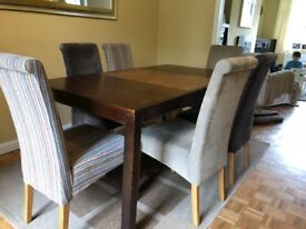 Wood dining table and 6 fabric chairs (two each color)