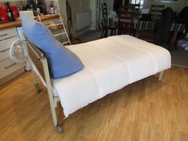 Metal Framed Single Bed, comes with plastic covered mattress, duvet and covers. Bed dismantles.