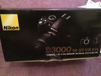 Nikon D3000 camera with 18-55mm lens boxe d with instructions as new condition
