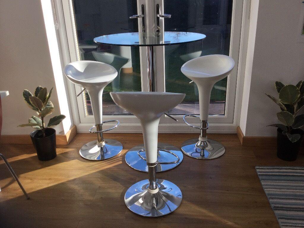 Dwell glass round bar table 3 white bar stools