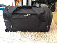 BMW M Sport luggage holds / roller case suitcase