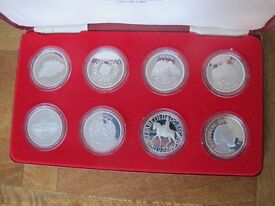 Set of 8 Sterling Silver Crown Coins