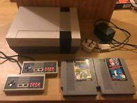 NES CONSOLE WITH 2 GAMES + 2 CONTROLLERS
