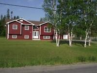 Newly constructed 3 BR c/w garage and 2 BR apartment above