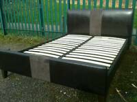 Nice faux leather King Size Bed (delivery available)