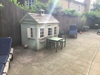 Cute Wendy house with shutters and window boxes