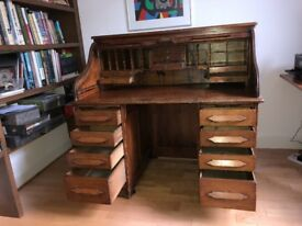 Victorian tambour top roll top desk, twin pedestal, on small castors