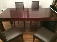Beautiful dining table & 4 chairs. Fits up to 6-8 seats