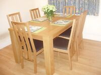 Oak effect dining table and six chairs for sale, Blandford.