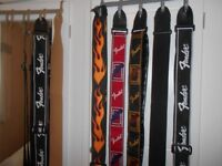 Fender guitar straps and book .Guitar stands and amp stand